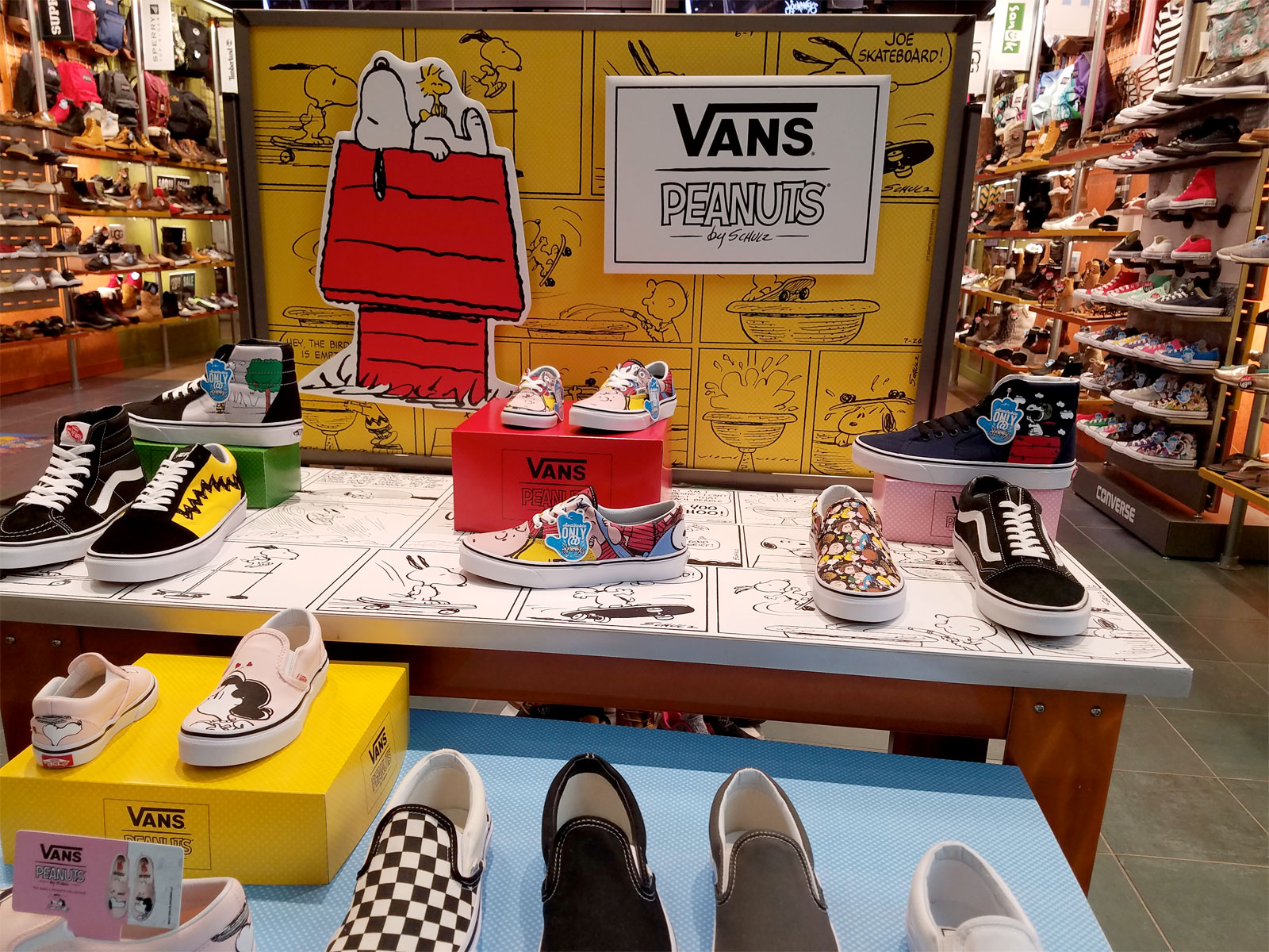 Vans shoes with various Peanuts themes